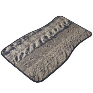 Paw prints and tire tracks on dirt road floor mats floor mat