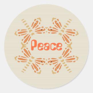 Peace, dragonflies in orange & tan on black round sticker