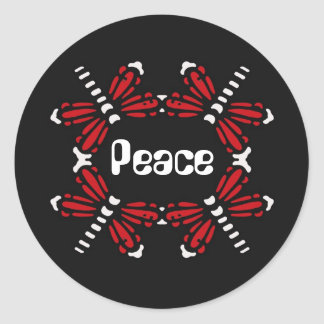 Peace, dragonflies in red & white on black round sticker