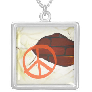 Peace symbol on wall, necklace