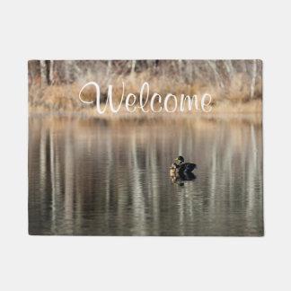 Peaceful pond in autumn with mallard ducks doormat