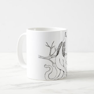 Peacock on a branch coffee mug