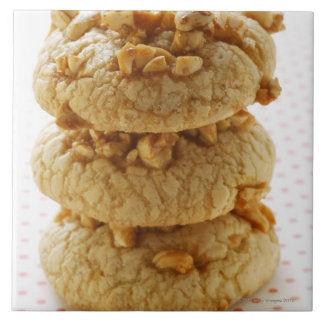 Peanut cookies in a pile large square tile