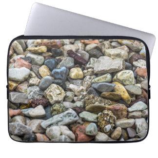 Pebbles on a beach laptop sleeve