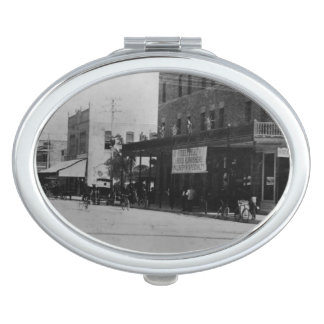 Pedestrians, cyclists, and horse-carriages vanity mirror