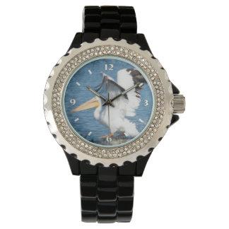 pelican taking off wristwatch