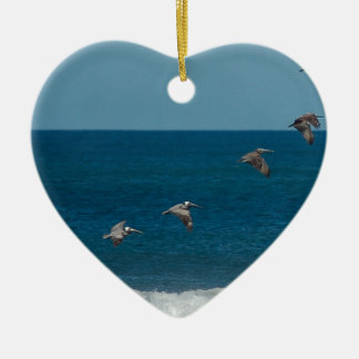 Pelicans flying in formation, Costa Rica Ceramic Heart Decoration