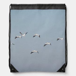 Pelicans in Flight Drawstring Bag