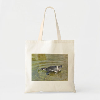 Penguin going swimming tote bag