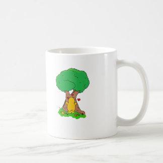 Penguin Hugging a Tree Coffee Mugs