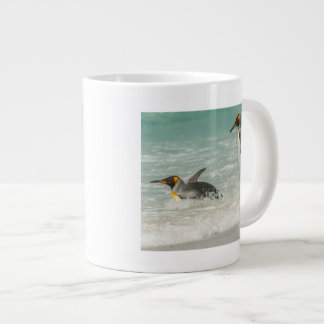 Penguins swimming on the beach large coffee mug