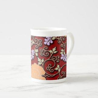Peonies arabesque on dark red tea cup