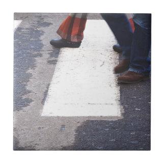 people crossing tile