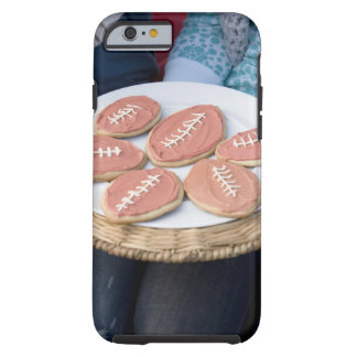 People holding plate of football cookies tough iPhone 6 case