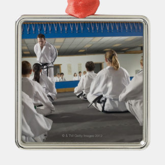 People in a tae kwon do class christmas ornament