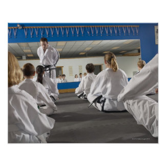 People in a tae kwon do class poster