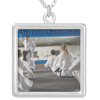 People in a tae kwon do class silver plated necklace