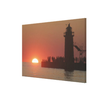 People lighthouse sunset silhouette at South Canvas Prints