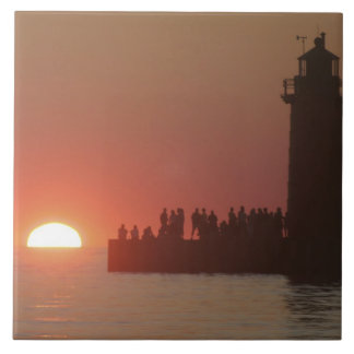 People lighthouse sunset silhouette at South Large Square Tile