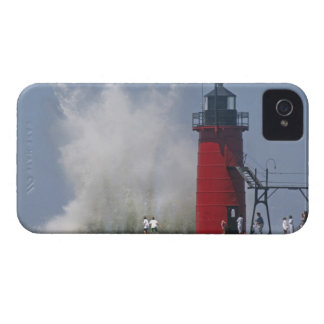 People on jetty watch large breaking waves in 2 iPhone 4 cover