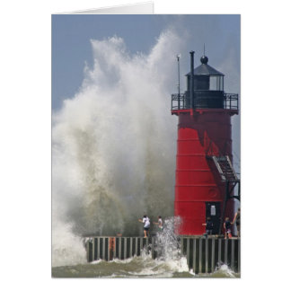 People on jetty watch large breaking waves in greeting card