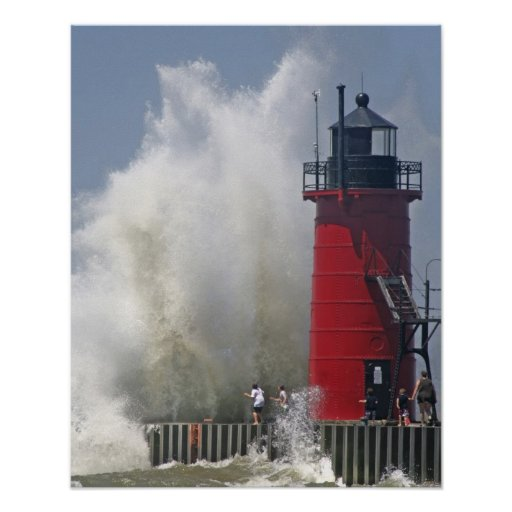 People on jetty watch large breaking waves in posters