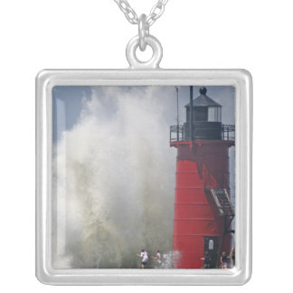 People on jetty watch large breaking waves in silver plated necklace
