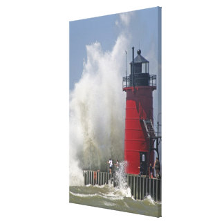 People on jetty watch large breaking waves in stretched canvas prints
