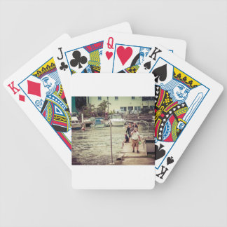 People on the pier 2 bicycle playing cards