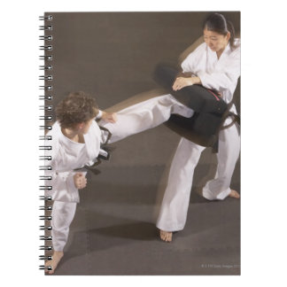 People practicing Tae kwon do Notebook