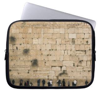 People praying at the wailing wall laptop sleeve