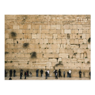 People praying at the wailing wall postcard