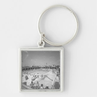 People relaxing at outdoor swimming pool B&W Silver-Colored Square Key Ring