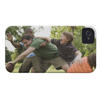 People tackling while playing football iPhone 4 case
