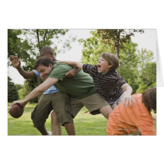 People tackling while playing football greeting card