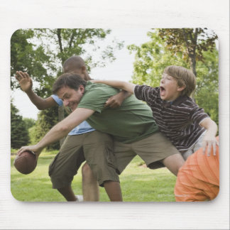 People tackling while playing football mouse pad