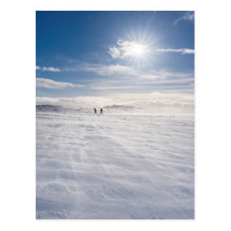 People walking over snow, Iceland Postcard