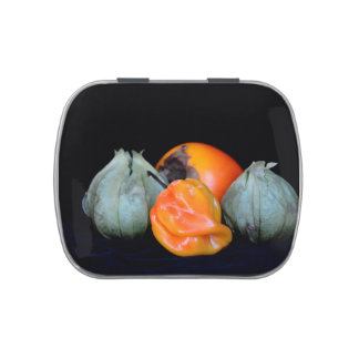 pepper tomatillo persimmon still life food image candy tin