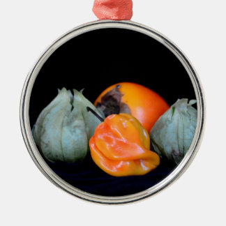 pepper tomatillo persimmon still life food image christmas ornaments
