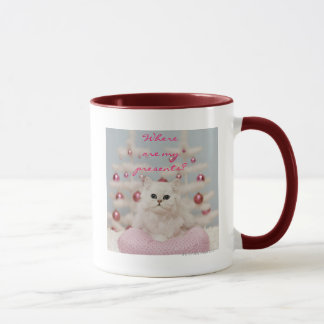 Persian cat sitting on pink pillow mug