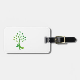 Person in yoga pose forming a healthy tree luggage tag