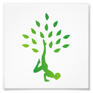 Person in yoga pose forming a healthy tree photo