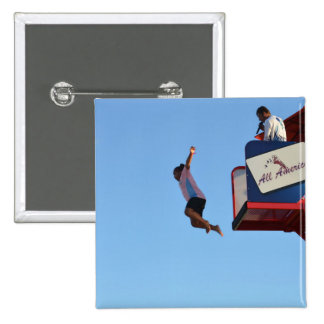 person jumping off of tower fair ride 15 cm square badge