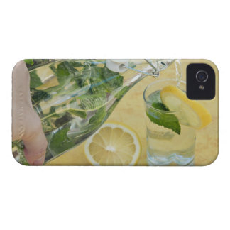 Person pouring water (mint-filled) into a glass iPhone 4 Case-Mate case