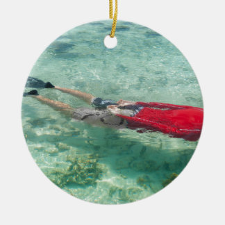 Person snorkeling in clear water christmas ornament