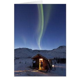 Person stands in doorway of Caribou Bluff cabin Card