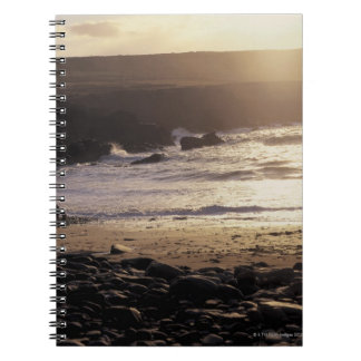 person with child walking on rocky beach spiral notebook