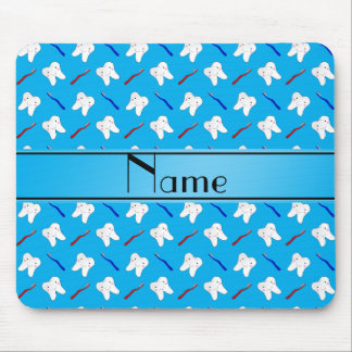 Personalized name blue brushes and tooth pattern mouse pad