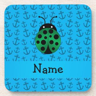 Personalized name ladybug blue anchors pattern beverage coasters