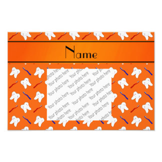 Personalized name orange brushes and tooth pattern photograph